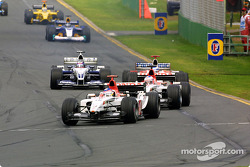 Jacques Villeneuve leads a group of cars