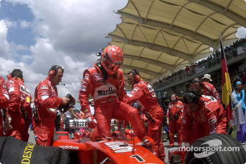 Michael Schumacher arrives on the starting grid