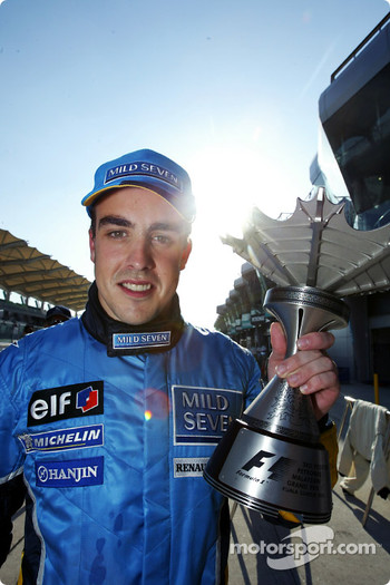 Fernando Alonso and his trophy