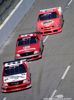 Terry Cook leads Bill Lester and Darrell Waltrip