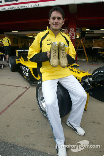 Giancarlo Fisichella presents his Puma Racing shoes