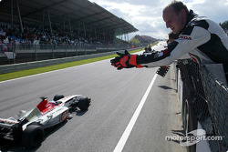 Jenson Button takes the checkered flag for the fourth place