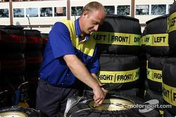 Michelin crew member prepares tires