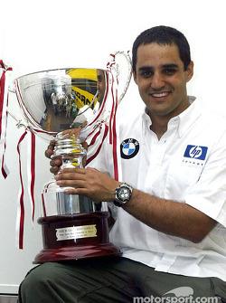 Race winner Juan Pablo Montoya celebrates victory