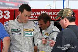 Johannes van Overbeek autographs a toy car for a fan.