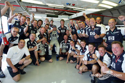Ralf Schumacher and Williams-BMW team members celebrate victory