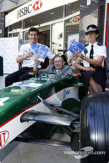 Mark Webber with local member of Parliament for Milton Keynes, MP Graham Mabbutt and a local WPC promote Milton Keynes new road safety guide at Milton Keynes central shopping area