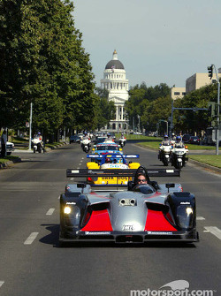 Gunnar Jeannette drives the JML Team Panoz entry as he leads Jeff Bucknum in the Team Bucknum Racing Pilbeam and Kevin Buckler in The Racers Group Porsche on a drive from the California State Capitol to Raley Field on Tuesday afternoon