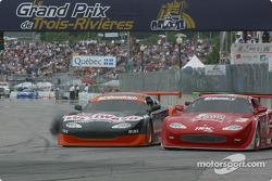 Michael Lewis tries to pass Claude Bourbonnais