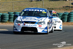 David Besnard being hounded by Jamie Whincup
