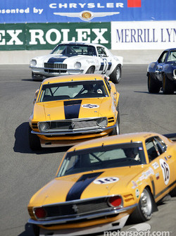 The corkscrew at Laguna Seca gets crowded during the first lap of the Historic Trans-Am race