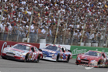 Kurt Busch leads Todd Bodine and Ricky Rudd