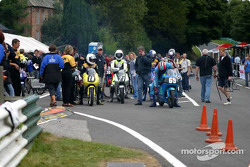 British 125cc pack warmup in pit lane