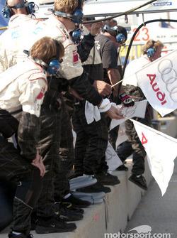 Audi team members prepare to celebrate