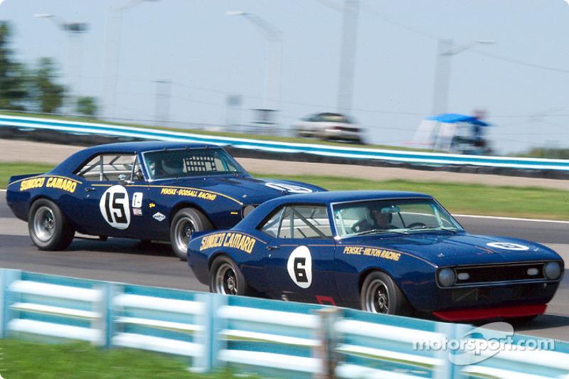 #6 1968 Chevrolet Camaro Z/28, owned by Pat Ryan leads #15 1967 Chevrolet Camaro Z/28, both originally driven by Mark Donohue