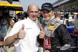 Volker Strycek and Timo Scheider celebrate pole position