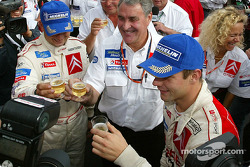 Champagne celebration for Daniel Elena, Guy Fréquelin, Sébastien Loeb and Citroën Sport team members