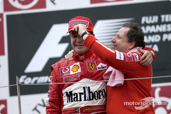 Podium: race winner Rubens Barrichello celebrates with Jean Todt