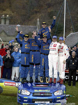 Winners Petter Solberg and co-driver Phil Mills with Sébastien Loeb and Daniel Elena, Tommi Makinen and Kaj Lindstrom