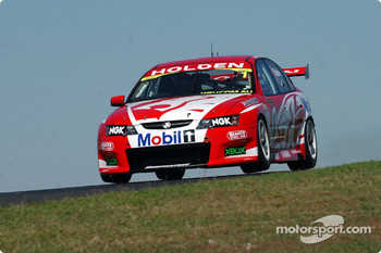 Mark Skaife gets airborne during the warm up