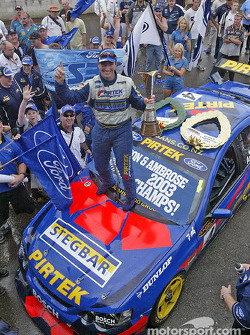 Race winner Marcos Ambrose celebrates victory and championship