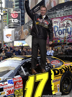 Matt Kenseth stands on the Championship winning Ford Taurus in Times Square