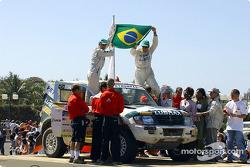 Klever Kolberg and Roldan Lourival celebrate on the finish podium