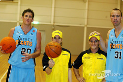 Nick Heidfeld with Giorgio Pantano and members of the Melbourne Giants basketball team