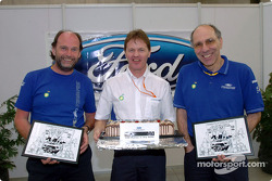 Team director Malcolm Wilson celebrates M-Sport's 100th world rally with fellow centurions George Black and John Millington