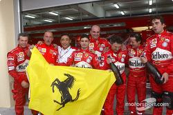 Ferrari team members celebrate another victory