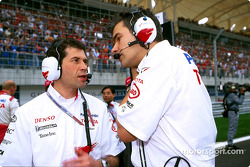 Toyota's Remi Decorzent, Da Matta's race engineer, talks to Dieter Gass, Chief Race Engineer