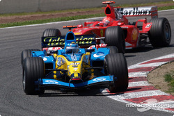 Jarno Trulli chased by Michael Schumacher