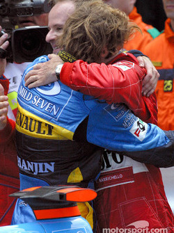 Jarno Trulli congratulated by Rubens Barrichello