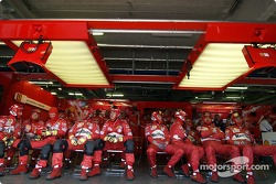 Ferrari team members watch race action