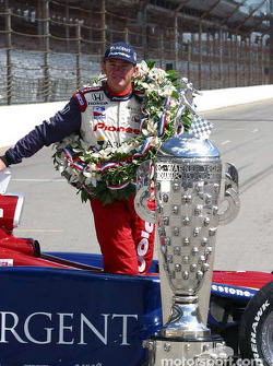 Buddy Rice with the Borg-Warner Trophy