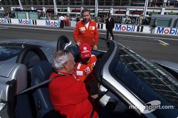 Jean Todt with Michael Schumacher before the start of the laps