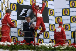 Podium: race winner Michael Schumacher with Kimi Raikkonen and Rubens Barrichello