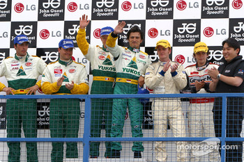 N-GT podium: winners Emmanuel Collard and Stphane Ortelli, with Sascha Maassen and Lucas Luhr, and Tim Mullen and Jonathan Cocker