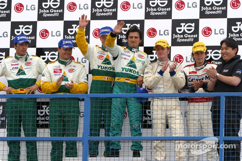 N-GT podium: winners Emmanuel Collard and Stéphane Ortelli, with Sascha Maassen and Lucas Luhr, and Tim Mullen and Jonathan Cocker