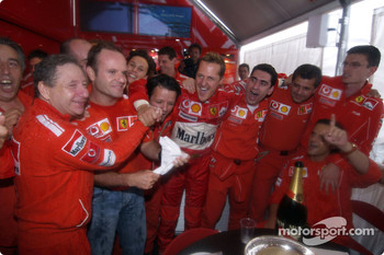 Michael Schumacher celebrates 7th World Championship with Rubens Barrichello, Jean Todt and Ferrari team members