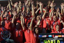 Ferrari team members celebrate 2004 Constructors World Championship