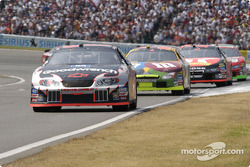 Kevin Harvick leads this pack out of turn one