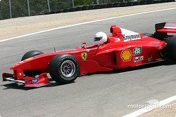 1999 Ferrari F1 car of Michael Schumacher driven by Frederico Kroymans, before…