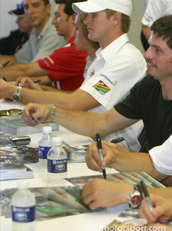 Autograph session: Ryan Hunter-Reay and Patrick Carpentier