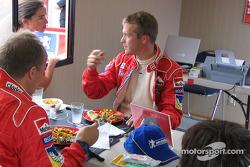 Quick lunch for Harri Rovanpera and Timo Rautiainen