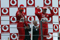 Podium: race winner Rubens Barrichello with Michael Schumacher