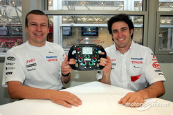 Olivier Panis and Ricardo Zonta with a signed steering wheel