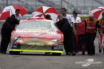 Ricky Rudd crew push his car out to qualify as the rain begins to fall