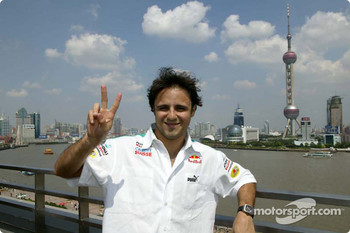Giancarlo Fisichella and Felipe Massa walk along the Bund