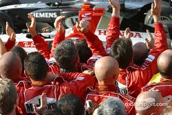 Ferrari team members celebrate victory